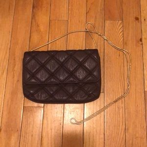 Quilted purple small bag with gold chain. NWOT
